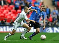 Photo: Tom Dulat.<br /> England v Estonia. UEFA European Championships Qualifying. 13/10/2007.<br /> Aleksandr Dmitrijev of Estonia and Joe Cole of England with the ball.