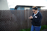 Daniela Mejia makes a quick note on her hand as she looks for encampments during the survey in Salinas.