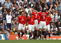 Photo: Leigh Quinnell.<br /> Tottenham Hotspur v Manchester United. The Barclays Premiership. 17/04/2006. Man Utds' Rio Ferdinand gets ready to give Wayne Rooney a big hug after scoring.