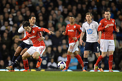 Tottenham's Mousa Dembele and Cardiff's Kim Bo-Kyung  compete for the ball - Photo mandatory by-line: Mitchell Gunn/JMP - Tel: Mobile: 07966 386802 02/03/2014 - SPORT - FOOTBALL - White Hart Lane - London - Tottenham Hotspur v Cardiff City - Premier League
