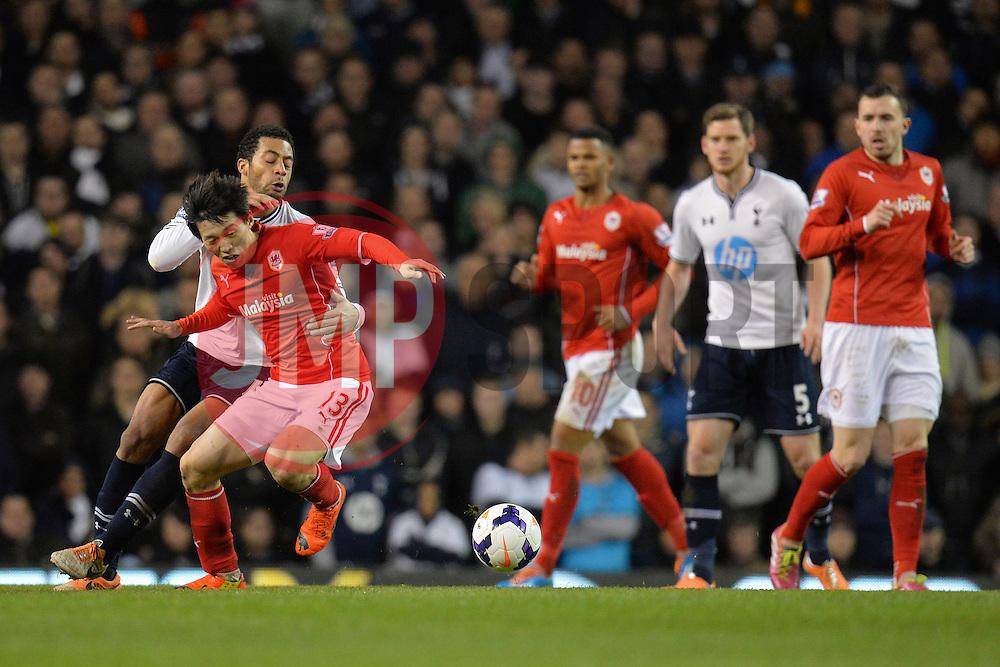 Tottenham's Mousa Dembele and Cardiff's Kim Bo-Kyung  compete for the ball - Photo mandatory by-line: Mitchell Gunn/JMP - Tel: Mobile: 07966 386802 02/03/2014 - SPORT - FOOTBALL - White Hart Lane - London - Tottenham Hotspur v Cardiff City - Premier League