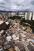 High-rise skyline of Caracas, Venezuela, with poor neighborhood in the foreground.