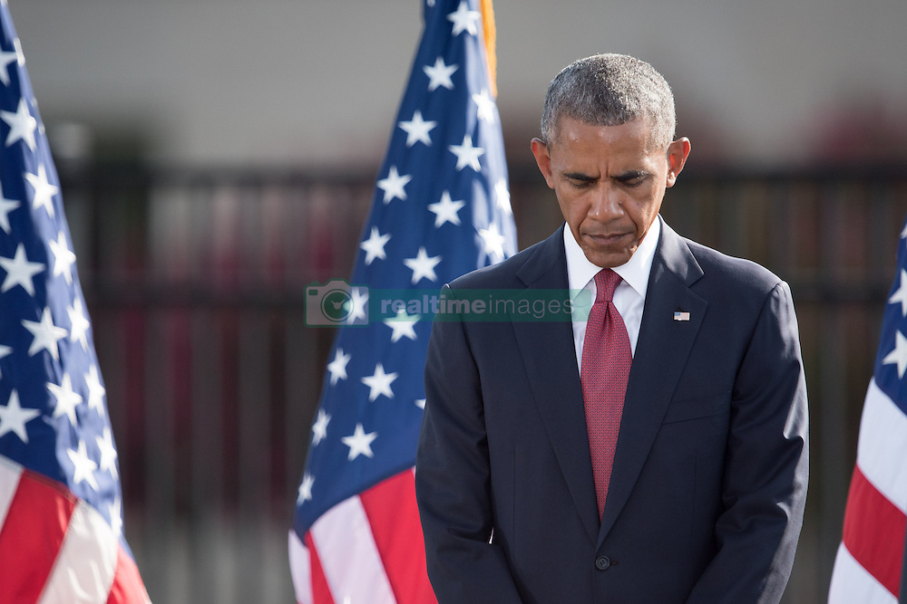 September 11, 2016 - Arlington, VA, United States of America - U.S President Barack Obama bows his head during a moment of silence at a remembrance ceremony commemorating the 15th anniversary of the 9/11 terrorist attacks at the Pentagon September 11, 2016 in Arlington, Virginia. (Credit Image: © Po2 Dominique A. Pineiro/Planet Pix via ZUMA Wire)