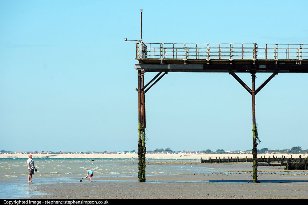 © Licensed to London News Pictures. 03/07/2014. Bognor Regis, UK . A man looks at the pier. People enjoy the hot sunny weather at the seaside resort of Bognor Regis today 3rd July 2014. Forecasters are predicting it to be the hottest day of 2014 so far. Photo credit : Stephen Simpson/LNP