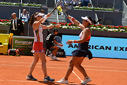 May 13, 2017 - Madrid, Spain - MARTINA HINGIS of Switzerland and YUNG-JAN CHAN of Tapei celebrate winning the doubles title in the Mutua Madrid Open tennis tournament. (Credit Image: © Christopher Levy via ZUMA Wire)