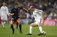 29/2/2004 Madrid, Spain.<br />La Liga (Spanish League) 26 day.<br />R.Madrid 4 - Celta 2<br />R.Madrid's Zidane in duel with Celta's Ilic at Santiago Bernabeu's Stadium.