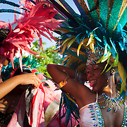 Colourful dancers at the parade. The Notting Hill Carnival has been running since 1966 and is every year attended by up to a million people. The carnival is a mix of amazing dance parades and street parties with a distinct Caribbean feel.