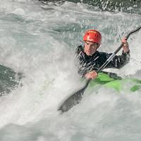 Kayaker Paul Manning-Hunter paddles through rapids in the Kananaskis River near Calgary, Alberta, Canada.