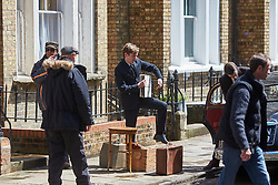© Licensed to London News Pictures. 19/05/2015. OXFORD, UK. Filming of ITV drama Endeavour, telling the story of the early life of Inspector Morse, taking place in Wellington Square in Oxford.<br /> <br /> In this picture: Shaun Evans (centre)(who plays Endeavour Morse) and Jack Laskey (2nd right - partially obscured) (who plays DS Peter Jakes)<br /> <br /> Photo credit : Cliff Hide/LNP