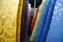 October 3, 2018 - Kathmandu, Nepal - A Nepalese woman dries screen-printed decorative paper made of Lokta raw materials at a factory in Lalitpur, Nepal on Wednesday, October 3, 2018. Lokta is a Daphne plant acquired from the bark of the Daphne bush, which grows abundantly in the Himalayan foothills at high altitudes. (Credit Image: © Skanda Gautam/ZUMA Wire)