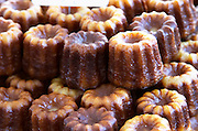 On a street market. On a street market. Caneles cakes. Bordeaux city, Aquitaine, Gironde, France