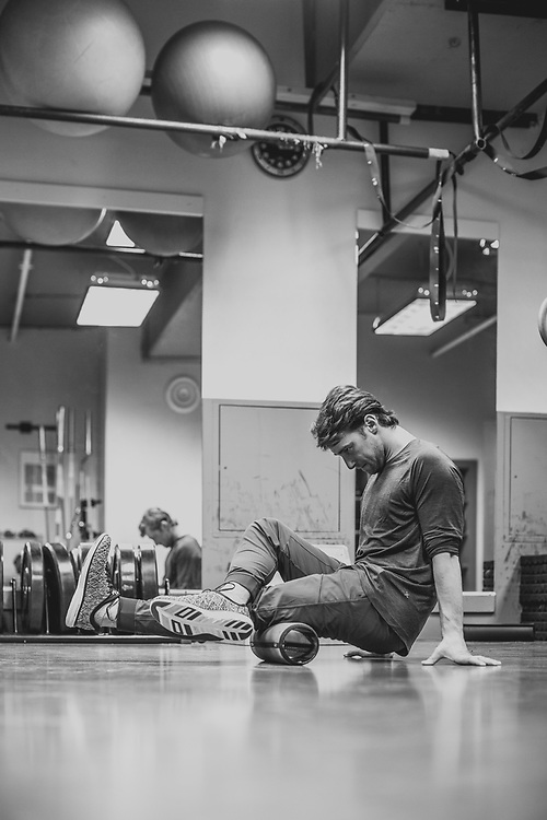 Professional snowboarder Craig McMorris spends some time stretching as part of his daily routine to help stay in peak physical condition.