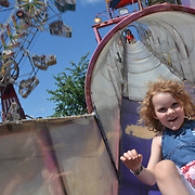 BATH, Maine -- 7/3/15 -- Eowyn Herrell, 5, of Seattle, slides down the Raiders chute at Bath Heritage Days on Friday. Photo © 2015 Roger S. Duncan