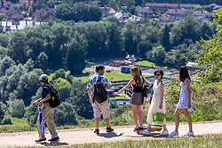 Licensed to London News Pictures. 18/07/2021. Dorking, UK. Walkers enjoy the scorching sunshine on Box Hill in Surrey today as weather forecasters predict a very warm and dry Weekend with highs of over 32c in the south East with the warm weather lasting for up to two weeks. Photo credit: Alex Lentati/LNP