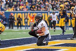 Nov 23, 2019; Morgantown, WV, USA; Oklahoma State Cowboys wide receiver Dillon Stoner (17) catches a pass for a touchdown during the fourth quarter against the West Virginia Mountaineers at Mountaineer Field at Milan Puskar Stadium. Mandatory Credit: Ben Queen-USA TODAY Sports