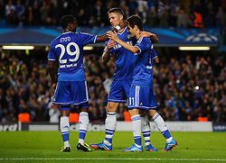 Chelsea Midfielder Oscar (BRA) celebrates scoring a goal with Midfielder Oscar (BRA) and Defender Gary Cahill (ENG) during the first half of the match - Photo mandatory by-line: Rogan Thomson/JMP - Tel: 07966 386802 - 18/09/2013 - SPORT - FOOTBALL - Stamford Bridge, London - Chelsea v FC Basel - UEFA Champions League Group E