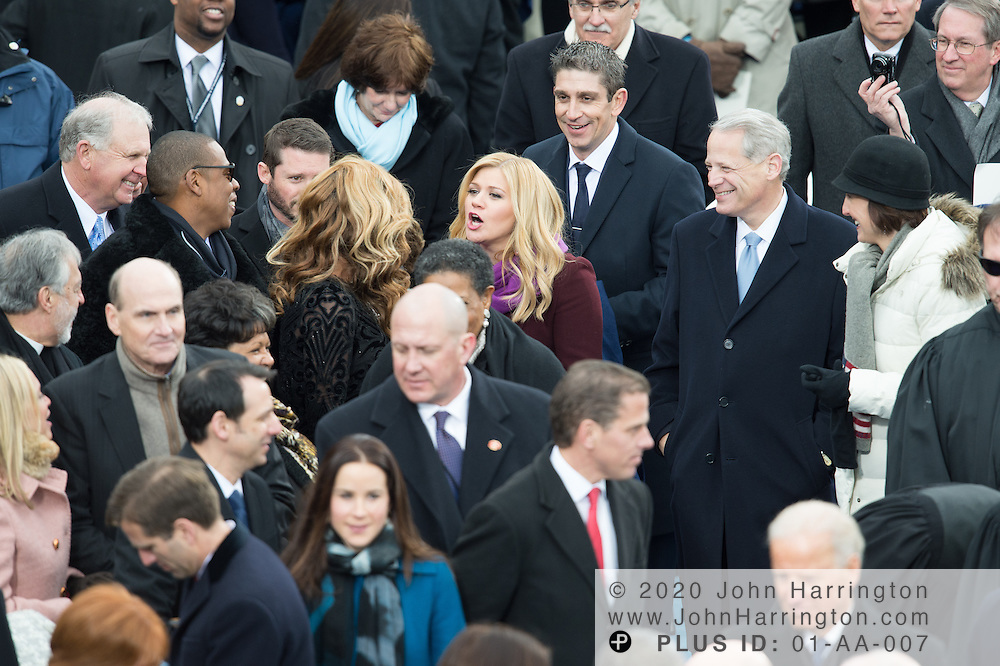 Kelly Clarkson congratulates Beyonce and Jay-Z after Beyonce's performance during the 57th Presidential Inauguration of President Barack Obama at the U.S. Capitol Building in Washington, DC January 21, 2013.