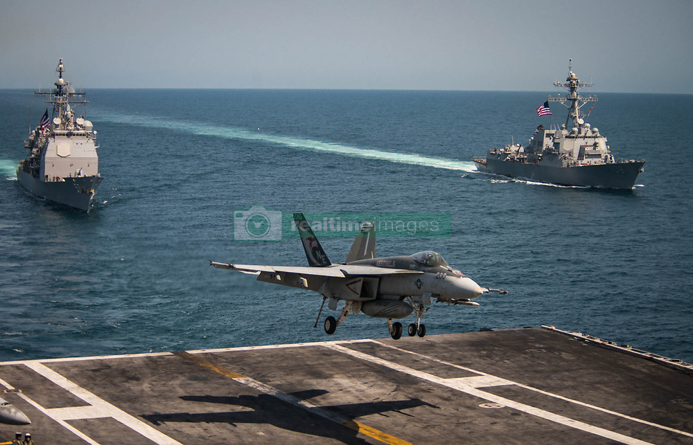 """PACIFIC OCEAN (May 3, 2017) An F/A-18E Super Hornet from the """"Kestrels"""" of Strike Fighter Squadron (VFA) 137 lands on the flight deck of the Nimitz-class aircraft carrier USS Carl Vinson (CVN 70) as the Ticonderoga-class guided-missile cruiser USS Lake Champlain (CG 57), left, and the Arleigh Burke-class guided-missile destroyer USS Wayne E. Meyer (DDG 108) transit the western Pacific Ocean. The U.S. Navy has patrolled the Indo-Asia-Pacific routinely for more than 70 years promoting regional peace and security. (U.S. Navy photo by Mass Communication Specialist 2nd Class Z.A. Landers/Released)170503-N-GD109-147 <br />Join the conversation:<br />http://www.navy.mil/viewGallery.asp<br />http://www.facebook.com/USNavy<br />http://www.twitter.com/USNavy<br />http://navylive.dodlive.mil<br />http://pinterest.com<br />https://plus.google.com"""