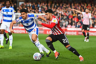 Brentford Forward Said Benrahma (21) and Queens Park Rangers Midfielder Massimo Luongo (21) in action during the EFL Sky Bet Championship match between Brentford and Queens Park Rangers at Griffin Park, London, England on 2 March 2019.