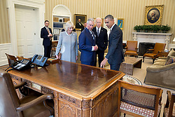 President Barack Obama and Vice President Joe Biden discuss the Resolute Desk with Charles, Prince of Wales and Camilla, Duchess of Cornwall, prior to a meeting in the Oval Office, March 19, 2015. (Official White House Photo by Pete Souza)<br /> <br /> This official White House photograph is being made available only for publication by news organizations and/or for personal use printing by the subject(s) of the photograph. The photograph may not be manipulated in any way and may not be used in commercial or political materials, advertisements, emails, products, promotions that in any way suggests approval or endorsement of the President, the First Family, or the White House.