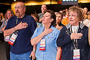27 FEBRUARY 2011 - PHOENIX, AZ: Members of the Tea Party Patriots say the Pledge of Allegiance at the Tea Party Patriots American Policy Summit in Phoenix Sunday, the last day of the conference. About 2,000 people were expected to attend the event, which organizers said was meant to unite Tea Party groups across the country. Speakers included former Minnesota Governor Tim Pawlenty, Texas Congressman Ron Paul, former Clinton advisor Dick Morris and conservative blogger Andrew Brietbart. The event ended with a presidential straw poll, which was won by Herman Cain, a newspaper columnist from Atlanta, GA.     Photo by Jack Kurtz