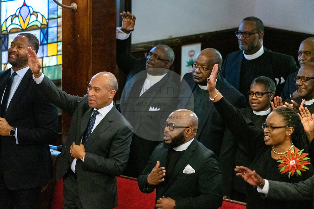 Democratic presidential hopeful Gov. Deval Patrick of Massachusetts, left, joins in the worship service at the historic Mother Emanuel AME Church January 1, 2020 in Charleston, South Carolina. The service celebrated Emancipation Day, marking the abolition of slavery in the United States.