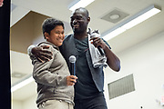 Rancho 7th grader Jaiden Tadeo raps with Isaiah Johnson, who plays George Washington for Hamilton in San Francisco, during a guest appearance for students at Rancho Middle School in Milpitas, California, on May 24, 2017. (Stan Olszewski/SOSKIphoto)