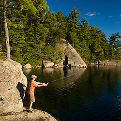 A man fishing on Sand Pond in Lempster, New Hampshire.