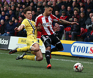 Sid Nelson tackling Andre Grey. Giving his all for Millwall during the Sky Bet Championship match between Brentford and Millwall at Griffin Park, London, England on 21 March 2015. Photo by Matthew Redman.
