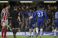 Mitchy Batshuayi of Chelsea hands the match ball to Willian of Chelsea for him to take a penalty . <br /> Premier league match, Chelsea v Stoke city at Stamford Bridge in London on Saturday 30th December 2017.<br /> pic by Kieran Clarke, Andrew Orchard sports photography.