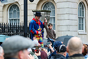 """A speaker gives a platform to a child to address to protesters who gathered holding placards during a """"Match the Million"""" march for free speech, free assembly, and freedom from lockdowns outside Downing Street in Central London, on Saturday, Oct 10, 2020. (VXP Photo/ Vudi Xhymshiti)"""