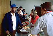 Volunteers serving Christmas dinner at church soup kitchen.  Minneapolis Minnesota USA