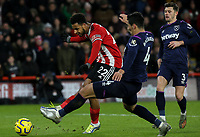 Sheffield United's Lys Mousset shoots under pressure from West Ham United's Fabian Balbuena<br /> <br /> Photographer Rich Linley/CameraSport<br /> <br /> The Premier League - Sheffield United v West Ham United - Friday 10th January 2020 - Bramall Lane - Sheffield <br /> <br /> World Copyright © 2020 CameraSport. All rights reserved. 43 Linden Ave. Countesthorpe. Leicester. England. LE8 5PG - Tel: +44 (0) 116 277 4147 - admin@camerasport.com - www.camerasport.com
