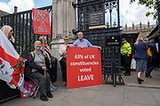 Brexit campaigners gather outside Houses of Parliament on the first day after summer recess on 3rd September 2019 in London in the United Kingdom. MPs return to Westminster for a Brexit shutdown that could result in a general election.