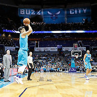 01 November 2015: Charlotte Hornets guard Jeremy Lin (7) takes a jump shot as Charlotte Hornets forward Nicolas Batum (5) and Charlotte Hornets forward Spencer Hawes (00) watch during the Atlanta Hawks 94-92 victory over the Charlotte Hornets, at the Time Warner Cable Arena, in Charlotte, North Carolina, USA.