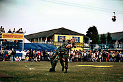 The marines visit Butlins holiday camp Skegness 1982 giving a disply to the crowd and encouraging recruitment during the Falklands war. Butlins Skegness is a holiday camp located in Ingoldmells near Skegness in Lincolnshire. Sir William Butlin conceived of its creation based on his experiences at a Canadian summer camp in his youth and by observation of the actions of other holiday accommodation providers, both in seaside resort lodging houses and in earlier smaller holiday campsThe camp began opened in 1936, when it quickly proved to be a success with a need for expansion. The camp included dining and recreation facilities, such as dance halls and sports fields. Over the past 75 years the camp has seen continuous use and development, in the mid-1980s and again in the late 1990s being subject to substantial investment and redevelopment. In the late 1990s the site was re-branded as a holiday resort, and remains open today as one of three remaining Butlins resorts.