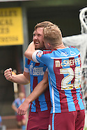 Scott Laird of Scunthorpe United celebrates Gary McSheffrey of Scunthorpe United at scoring to go 1 all during the Sky Bet League 1 match between Scunthorpe United and Shrewsbury Town at Glanford Park, Scunthorpe, England on 17 October 2015. Photo by Ian Lyall.