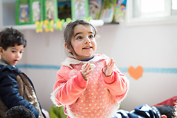 17 February 2020, Zarqa, Jordan: A girl claps her hands in 'the nanny room' at the Lutheran World Federation community centre in Zarqa. Through a variety of activities, the Lutheran World Federation community centre in Zarqa serves to offer psychosocial support and strengthen social cohesion between Syrian, Iraqi and other refugees in Jordan and their host communities.