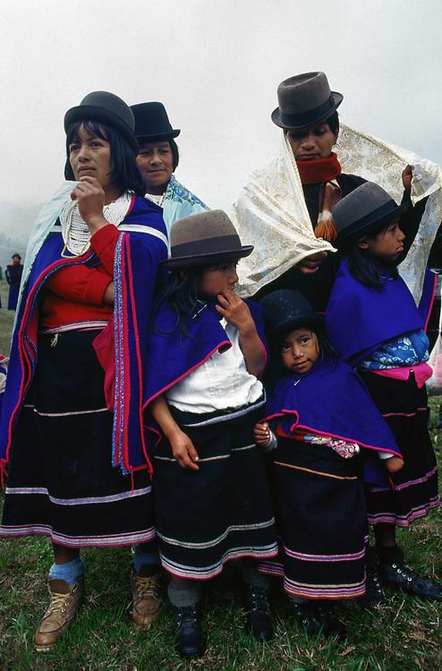 Guambiano Indians stand in rain shower, Silvia, Cauca, Colombia. |