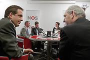 Alexander Pechtold (D'66) en Job Cohen (PvdA) hebben een onderonsje terwijl Machiel de Graaf in de debat is. Bij de NOS wordt het eerste lijsttrekkersdebat gehouden voor de Provinciale Statenverkiezing. Behalve de SGP en de Christen Unie had iedere partij een lijsttrekker uit de Eerste of Tweede Kamer afgevaardigd.<br /> <br /> Alexander Pecthold, leader of the Democrats D'66, and Job Cohen, leader of the labour party PvdA, are talking to each other, while Machiel de Graaf (PVV) is having a debate on the radio.
