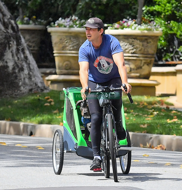 EXCLUSIVE: Shia Labeouf and his wife Mia Goth take their pup out for a bike ride in their Pasadena neighborhood. 12 May 2020 Pictured: Shia LaBeouf and Mia Goth. Photo credit: MARKSMAN / MEGA TheMegaAgency.com +1 888 505 6342