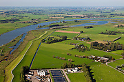 Nederland, Overijssel, Zwolle, 03-10-2010; de IJssel ter hoogte van Westenholte. In het kader van het programma Ruimte voor de rivier zal de dijk landinwaarts verlegd worden (direct na de rioolwaterzuivering, onder in beeld). Ook worden er geulen gegraven die zullen aansluiten op de bestaande geul (boven in beeld). Door de dijkverlegging worden de uiterwaarden breder en krijgt de rivier meer ruimte..River IJssel north of Zwolle. There are plans to move the river dike inland and new 'channels' will be dug that will connect with the existing channel (top image). Moving the dike will broaden the floodplains creating more space for the river..luchtfoto (toeslag), aerial photo (additional fee required).foto/photo Siebe Swart