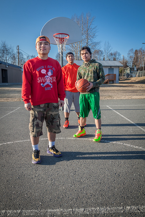 """Roy Villahermosa (L), Rick Villahermosa (ball), and Leo Andres Jr. (back) during a shoot around at Inlet View Elementary School, Anchorage  """"My mother moved here from the Phillipines""""  """"What do you like most about living in Anchorage?""""  """"The weather""""  rick_villahermosa@yahoo.com"""