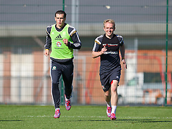 NEWPORT, WALES - Tuesday, October 7, 2014: Wales' Gareth Bale and Jonathan Williams training at Dragon Park National Football Development Centre ahead of the UEFA Euro 2016 qualifying match against Bosnia and Herzegovina. (Pic by David Rawcliffe/Propaganda)