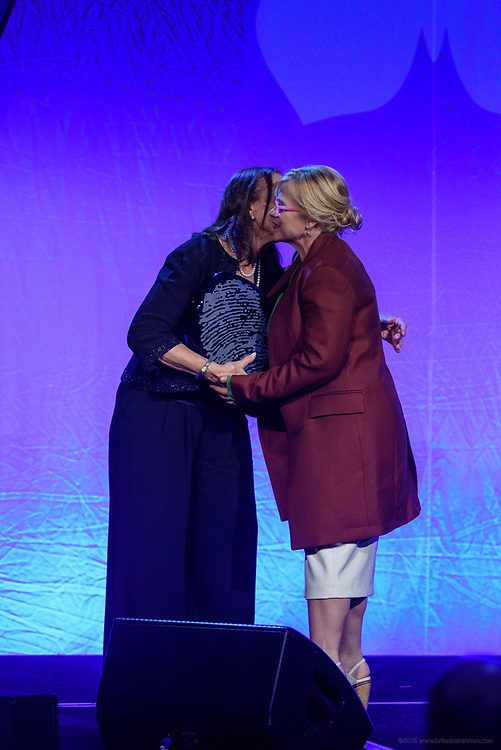 Lonnie Ali, widow of Muhammad Ali and Co-Founder of the Muhammad Ali Center, presents Patricia Arquette, Academy Award-winning actress, activist, founder of GiveLove and humanitarian, with the Muhammad Ali Humanitarian Award for Lifetime Achievement at the fifth annual Muhammad Ali Humanitarian Awards Saturday, Sept. 23, 2017, at the Marriott Louisville Downtown in Louisville, Ky. (Photo by Brian Bohannon/Invision for Muhammad Ali Center/AP Images)
