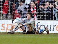 Photo: Leigh Quinnell.<br /> Nottingham Forest v Swindon Town. Coca Cola League 1. 25/02/2006. Swindon goalkeeper Rhys Evans can't belive it as the seventh goal goes past him.