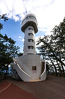 Kadowaki Lighthouse is nearly 25 meters in height, with observation decks for visitors to view the coastline.  The spiral staircase in the lighthouse is very narrow -  only one adult can pass at a time, consequently here are two separate staircases for upward and downward, people going up and down can avoid colliding into each other. Mt. Amagi-renzan and Mt. Omuro-yama can be viewed from here. Facing the direction of the sea, the wild coastline formed by rough stones and boulders can be viewed.