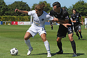 Auckland City FC's Yousif Al-Kalisy competes for the ball against Hawke's Bay United's Sam Pickering in the Handa Premiership football match, Hawke's Bay United v Auckland City FC, Bluewater Stadium, Napier, Sunday, January 31, 2021. Copyright photo: Kerry Marshall / www.photosport.nz