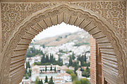 The Alhambra Palace and fortress complex located in Granada, Andalucia, Spain. Moorish architectural design details inside the Partal Palace.