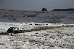 © Licensed to London News Pictures. 11/04/2021. Builth Wells, Powys, Wales, UK. An unseasonal wintry landscape on the Mynydd Epynt range near Builth Wells in Powys, Wales, UK. Photo credit: Graham M. Lawrence/LNP